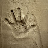 Hand print on cement mortar wall Stock Photo