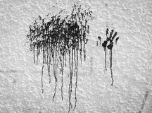 Hand print with dripping black paint Royalty Free Stock Images