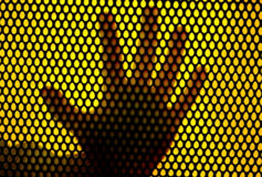 Hand print in metal net Stock Photo