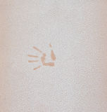 Hand print on the orange, beige wall, Stock Photos