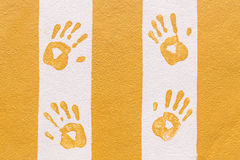 Hand print on orange and white wall Royalty Free Stock Image