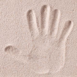 Hand print in sand Royalty Free Stock Photo