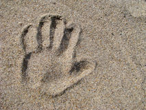 Hand print in sand Royalty Free Stock Photos
