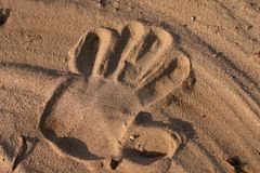 Hand print in sand Royalty Free Stock Images