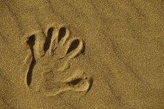 Hand Print in Sand. Hand Print in the Beach Sand Closeup. Hand Print Background Stock Photos