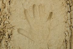 Hand print in the sand Stock Image