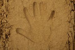 Hand print in the sand Royalty Free Stock Photography