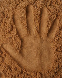 Hand print on sand Royalty Free Stock Photo
