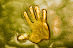 Hand print in a sand and light table Royalty Free Stock Photography