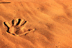 Hand print in the sand in the Namib desert. Royalty Free Stock Images