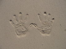 Hand print on sandy beach Royalty Free Stock Image