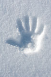 Hand print in snow Stock Photos