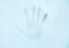Hand print on a snow Royalty Free Stock Photos
