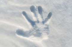 Hand print in snow Stock Image