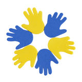 Hand print stickers of different colors. On the white background Royalty Free Stock Photography