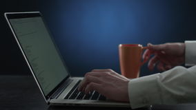 Hand print text on the keyboard and drink tea. Hand print text on the keyboard blue style stock footage