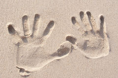 Hand prints. On the sand stock photo