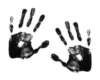Hand prints. Two adult black hand prints royalty free stock images