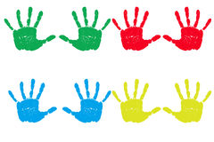 Hand prints. Multiple handprints in multiple primary colors and isolated on a white background lined up royalty free stock photography