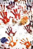 Hand prints. Color hand prints painted on a white wall Royalty Free Stock Photo
