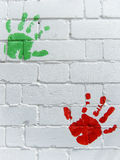 Hand prints. Green and red hand prints on wall royalty free stock images