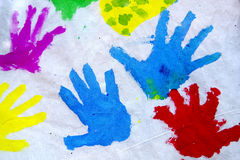 Hand Prints. Children's colorful hand prints over white canvas Stock Images