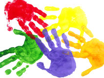 Hand prints. Color hand prints painted on a white paper Royalty Free Stock Image