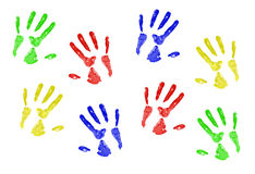 Hand Prints. In primary colors on a white canvas stock photo
