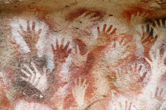 Hand prints on a cave wall cueva de las manos Royalty Free Stock Photography