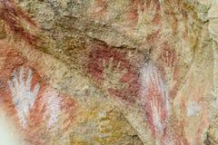 Hand prints on a cave wall. Cave of Hands in Argentina, cueva de las manos stock photos