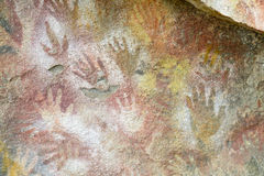 Hand prints on a cave wall. Cave of Hands in Argentina, cueva de las manos stock images