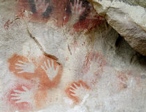 Hand prints on a cave wall Stock Photo