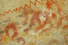 Hand prints on a cave wall Stock Images