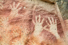 Hand prints on a cave wall Stock Image