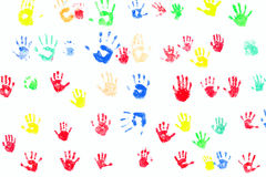 Hand prints diversity. Colorful painted childrens / kids hand prints on a white wall. Diversity concept stock photos
