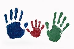 Hand prints of family colored paint on white background stock photos
