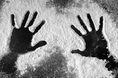 Hand prints in flour Stock Photos