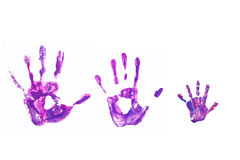 Hand prints of his father, mother and child. Royalty Free Stock Images