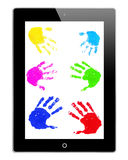 Hand prints on iPad. Colorful hand prints on an iPad monitor Stock Images