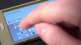 Hand prints a message to somebody on modern mobile phone, close up, black stock footage