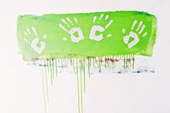 Hand prints on paint Royalty Free Stock Images