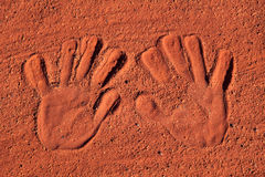 Hand prints in red sand Royalty Free Stock Photo