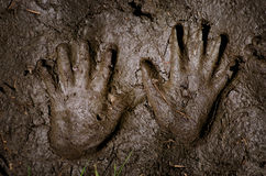 Hand prints on the sand. Handprints on the sand, mude royalty free stock photos