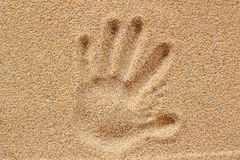 Hand prints on sand stock images