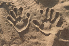 Hand prints in the sand. Hand prints on the sand. sunny Beach Royalty Free Stock Image
