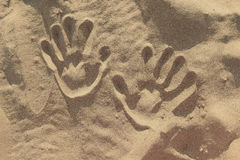 Hand prints in the sand. Hand prints on the sand. sunny Beach Stock Image