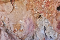 Hand prints, Pigment Sprayed by Mouth on rock by Aboriginies. Photo of imprints of a hands sprayed with natural ochre. Over 5,000 years old, Circa 5,000 plus stock photography