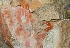 Hand prints on stone cave wall Royalty Free Stock Photos