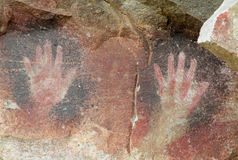 Hand prints on wall Cave of Hands in Argentina stock photography