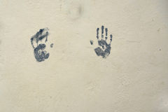 Hand prints on wall in paint. Two hand prints on wall in paint stock images